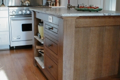 White Oak Island in Contrast To Painted Surrounding Cabinets